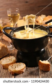 cheese fondue with wine and bread