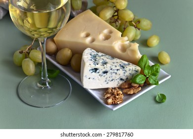 Cheese with fruits on the kitchen table