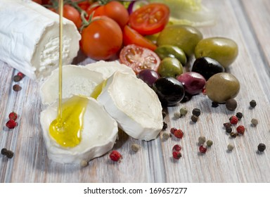 Cheese Goat with tomato cherry, olives, and olive oil
