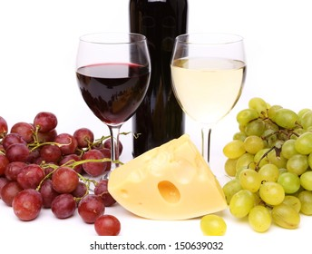 Cheese, grape, raisins, bottle and glasses of wine. White background.