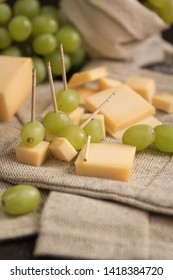 cheese and grapes on a stick