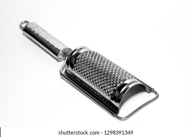 Cheese grater, hand stainless steel grater isolated on white background on white background
