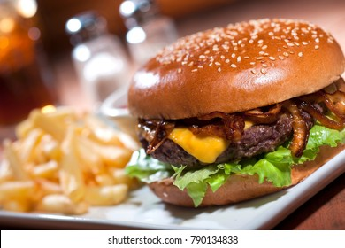 Cheese hamburger with french fries and egg.