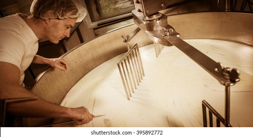Cheese maker -Traditional cheese making at a creamery,