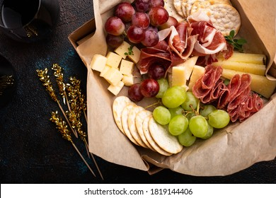 Cheese and meat assortment in a to go box, food delivery or catering concept