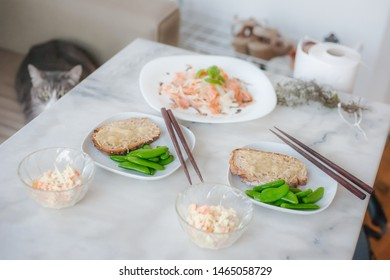Cheese melted on bread and salads as a healthy breakfast in France