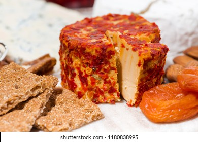 cheese with mold and snacks, closeup horizontal