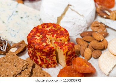 cheese with mold and snacks, top view, horizontal