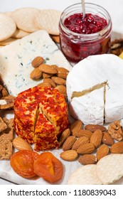 cheese with mold and snacks, top view