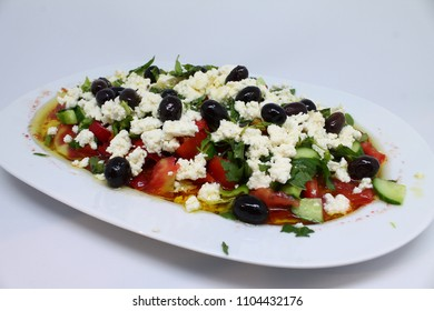 cheese, olive, olive oil delicious and healthy salad on the plate. white background isolated salad