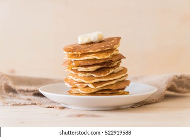 cheese on pancake stack with honey