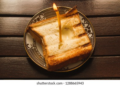 Cheese on toast with a candle in the middle, cheap birthday cake.