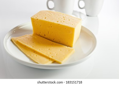 cheese on a white reflexive background