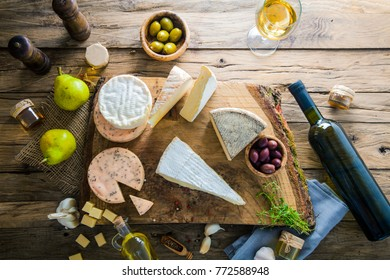 Cheese on wood. Types of cheese and herbs on wood