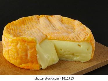 Cheese on woodboard - dark background
