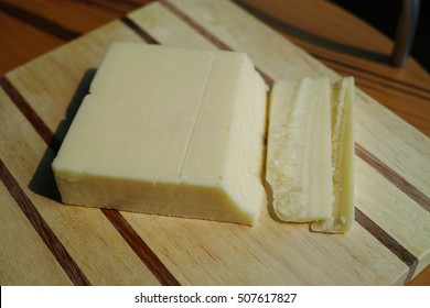 cheese  on a wooden board