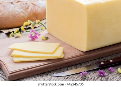Cheese on a wooden Boards, white bread, sliced cheese