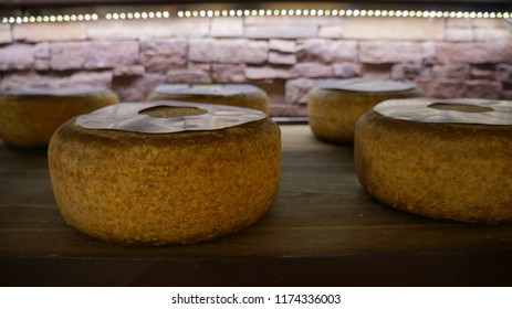 Cheese on wooden shelf