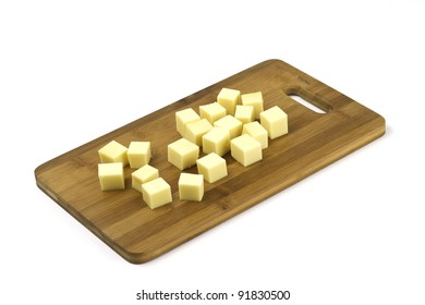 cheese parts on a board