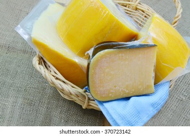 cheese with  plastic package in basket