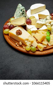 Cheese plate with Assorted cheeses Camembert, Brie, Parmesan blue cheese, goat
