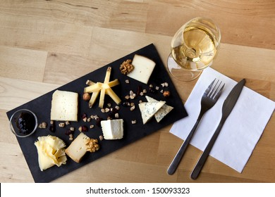 Cheese plate and glass of white wine in a French bistro
