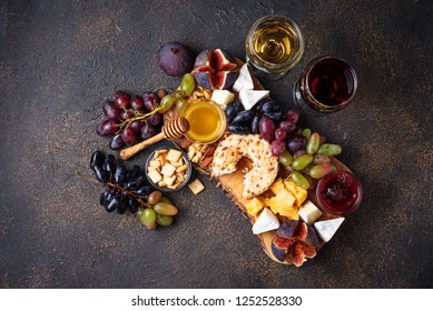 Cheese plate with grapes, figs, dips and wine. Top view