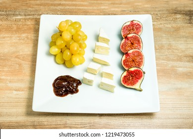 Cheese plate with grapes and figs. Wine snaks.