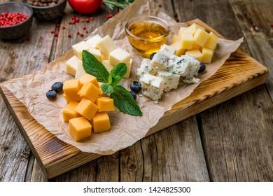 Cheese plate italian food on wooden board