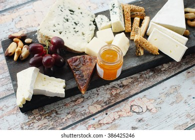Cheese plate on wooden background