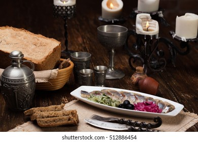 Cheese plate, parmesan, Dor Blue, Camembert. Against the backdrop of a still life of a medieval