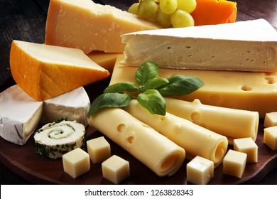 Cheese plate served with grapes, various cheese on a platter.