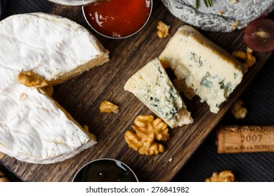 Cheese plate served with jam and honey top view