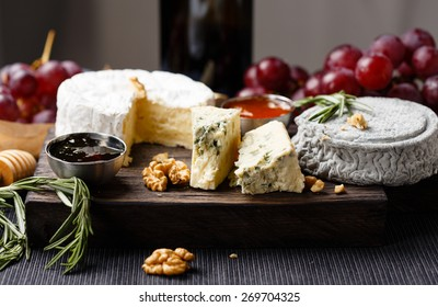 Cheese plate  served with wine, gam and honey close-up