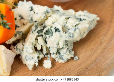 Cheese platter closeup. Delicious blue cheese. Macro. Photo can be used as a whole background.