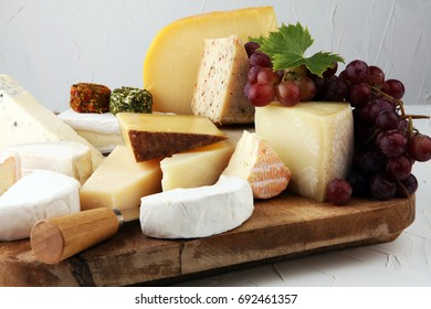 Cheese platter with different cheese and grapes with camembert