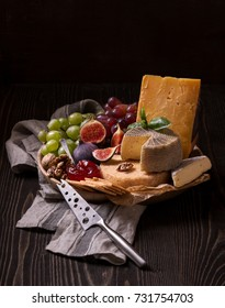 Cheese platter on the rough wood
