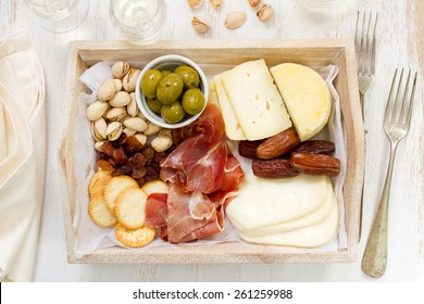 cheese with prosciutto, cookies, olives and wine