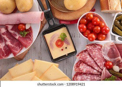 cheese raclette with ham and potato