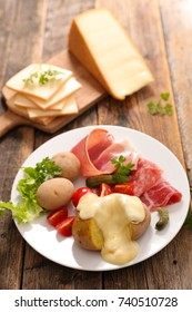 cheese raclette with potato and ham