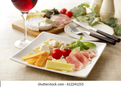 Cheese and raw ham hors d 'oeuvres