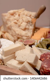 A cheese and salami platter with eggs and pickles