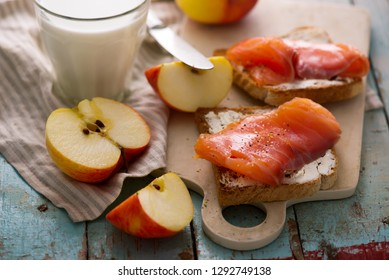 Cheese and  salmon sandwiches  apples. Healthy breakfast. selective focus.