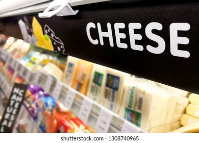 Cheese signage at the fresh chiller refrigerated section of supermarket hypermarket