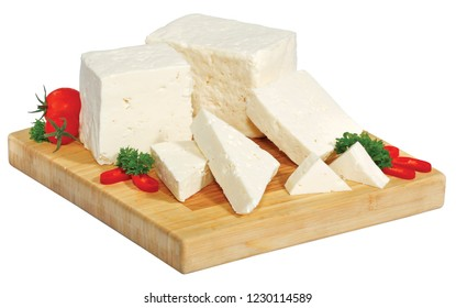 cheese sliced on a wooden board