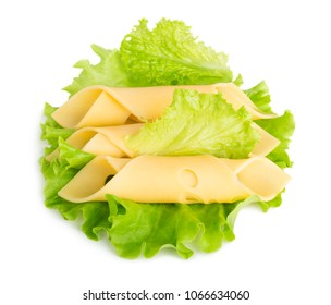 Cheese slices on green salad leaves isolated on white background