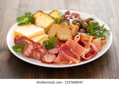 cheese with smoked meat on white dish