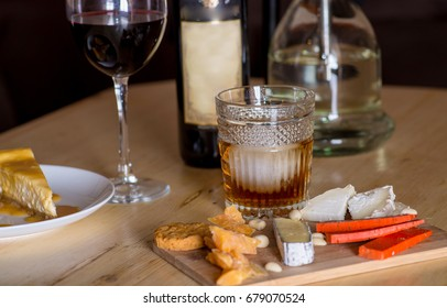 Cheese snacks and alcohol on the table in the restaurant