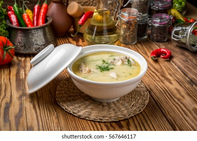 Cheese soup with chicken and vegetables in a plate