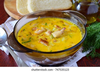 Cheese soup with smoked chicken, potato and cream.
